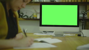 Writing code for ux on paper. view1. Screen For. Focus on monitor. Closeup of writing a text on paper. In the picture you can see the focus on monitor in the stock footage