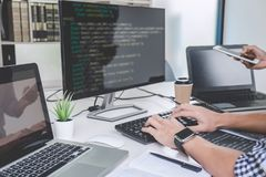 Writing codes and typing data code technology, Programmer cooper stock images