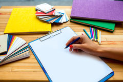 Writing with color pencil on the white sheet of Royalty Free Stock Images