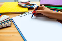 Writing with color pencil on the white sheet of Royalty Free Stock Photography