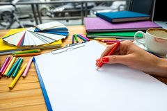 Writing with color pencil on the white sheet of Royalty Free Stock Image