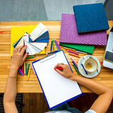 Writing with color pencil on the white sheet of Stock Photo