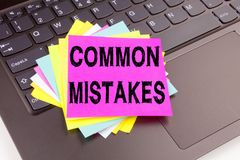 Writing Common Mistakes text made in the office close-up on laptop computer keyboard. Business concept for Common Decision Mistake Royalty Free Stock Photo