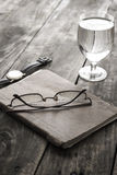 Writing concept: glasses, notes, glass of water Stock Images