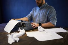 Writing Concept. Portrait of unrecognizable writer using old typewriter, copy space stock images