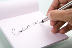 Writing 'contact us' Stock Image