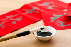 Writing the couplet for chinese new year Royalty Free Stock Images