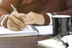 Writing dairy on notebook in coffee shop, concept as memory of life. And education stock photography