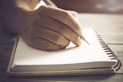 Writing dairy on notebook in coffee shop, concept as memory of life. And education stock image