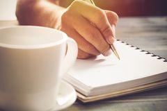 Writing dairy on notebook in coffee shop, concept as memory of life. And education royalty free stock photography