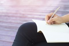 Writing dairy on notebook, concept as memory of life. And education stock photos