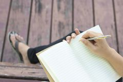 Writing dairy on notebook Royalty Free Stock Photography