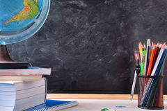 Free Writing Desk With School Tools And Blackboard Royalty Free Stock Images - 74067099