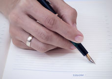 Writing in diary. Close up photo Stock Photo