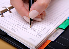 Writing in diary Stock Images