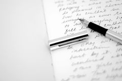 Writing diary with pen stock photo