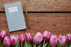 Writing diary spring atmosphere pink tulips. Writing a love letter for valentines day creating a spring poem notes for easter recepie royalty free stock images