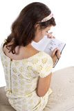 Writing on Diary. Young female writing on a retro style diary with text space Royalty Free Stock Photo