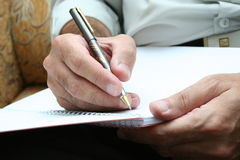 WRITING IT DOWN. Writing a contract Stock Image