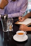 Writing down business ideas Stock Image