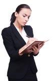 Writing down her ideas. Stock Photos