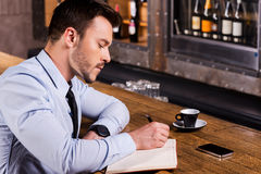 Writing down his fresh ideas. Royalty Free Stock Photos