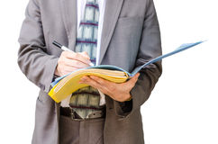Writing down his ideas. Businessman with a document file in hand Stock Images
