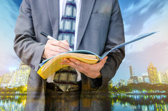 Writing down his ideas. Businessman with a document file Royalty Free Stock Image