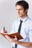 Writing down his thoughts. Royalty Free Stock Photography