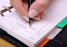 Writing down a note. Hand writing down a note with a pen royalty free stock image
