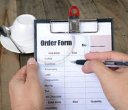 Writing drinking order. Stock Images