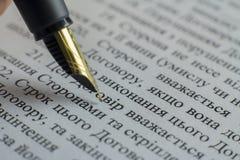 Writing elite pen macro on white A4 document Stock Photography