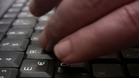 Writing an Email - Close-Up. Close-up shot of a person typing on a computer keyboard. Canon HV30. HD 16:9 1920 x 1080 at 25.00 fps. Progressive scan. Photo JPG stock video