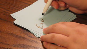 Writing energetic. Hand writing the word energetic on a card stock video footage