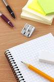 Writing equipment on desk Stock Photography