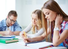 Writing essay Royalty Free Stock Photos
