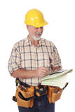 Writing an estimate. Older construction worker writing out an estimate; isolated on white stock photo
