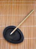writing för bambuborstecalligraphy Fotografering för Bildbyråer