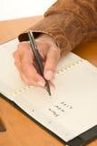 writing för planner för man för daghandlivstid ny arkivfoto