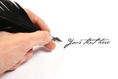 Writing with feather Royalty Free Stock Photography