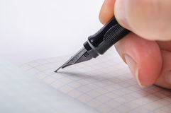 Writing feather ink pen point Stock Photography
