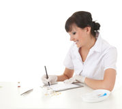 Writing female doctor or researcher Stock Photography