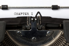 Writing the first chapter. The words Chapter I written onn old typewriter stock photos