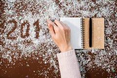 Writing 2018 flour. Christmas art design hand figures new year decoration Royalty Free Stock Image