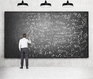 Writing formulas on the blackboard Stock Photography