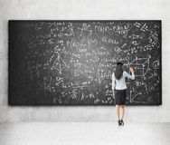 Writing formulas on the blackboard Stock Images