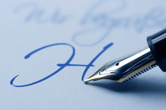 Writing fountain pen. Letter H written with a fountain pen Royalty Free Stock Image
