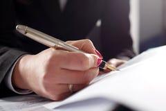Writing fountain pen head. Business woman writing fountain pen head Stock Photo