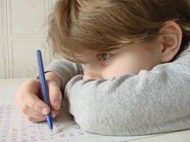 Writing girl. Little pupil girl with primary homework writing Royalty Free Stock Photos