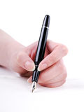 Writing with Gold Pen Royalty Free Stock Photo